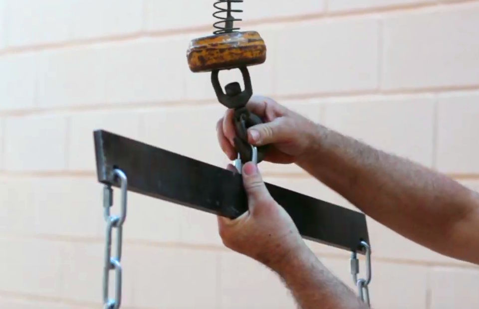The balance beam column hook helps to raise the chutes.